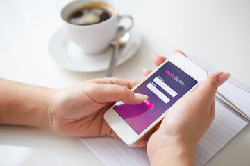 Female hands using mobile banking