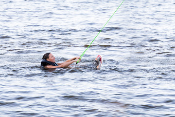 Woman study riding on a wakeboard