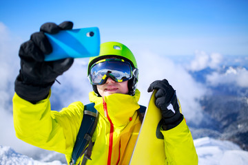 Man in winter clothes taking a selfie