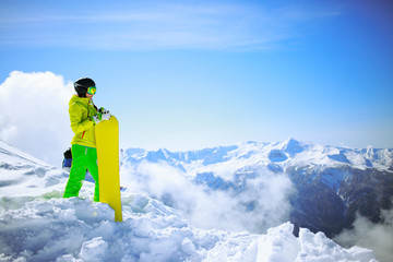 snowboarder against sun and mountains Wall mural