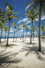 Copacabana Beach with palms and shadows in Rio