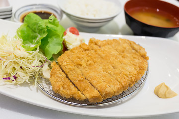 Tonkatsu - Japanese breaded deep fried pork cutlet with steamed