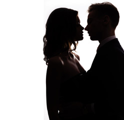silhouette vlublennoj happy couple kissing on a white background