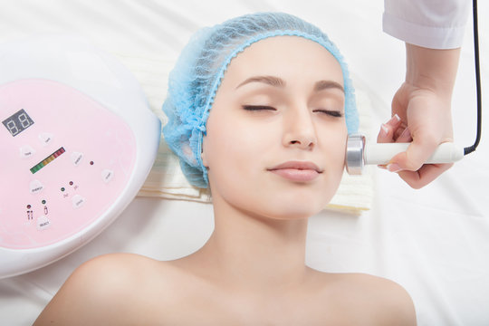 woman getting ultrasound skin cleaning at beauty salon