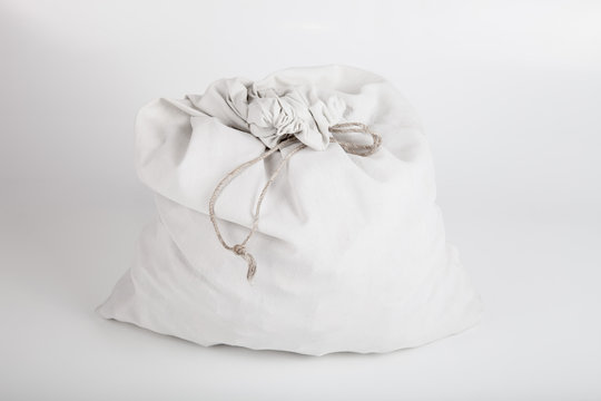White linen bag with a rope on a light background