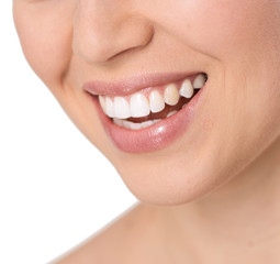 Close-up of beautiful healthy woman's smile with white teeth