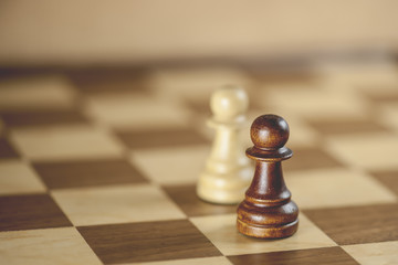 Chess pieces and game board background (Shallow DOF)