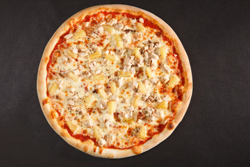 Tasty Italian pizza with pineapple chicken and cheese