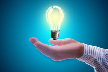 Light bulb on hand businessman