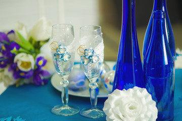Bridal bouquet glasses and bottles of blue