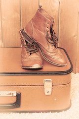 Retro suitcase with male shoes