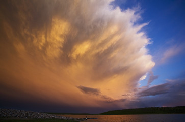 A cloud formation, a storm cloud reflecting sunlight.