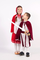 Girl and boy in costumes from fairy tales
