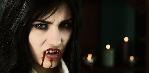 Scary female vampire angry looking camera