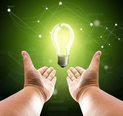Bulb light on two hand of man