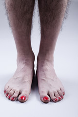 Man's Feet with Red Nail Polish and Hairy Legs