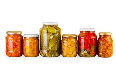Canning. Home Canning Jars of Summer Harvest Vegetable on White