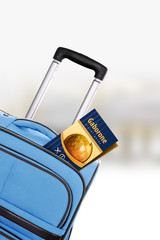 Gaborone. Blue suitcase with guidebook.