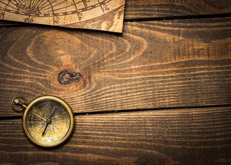 Map. Old compass and vintage maps
