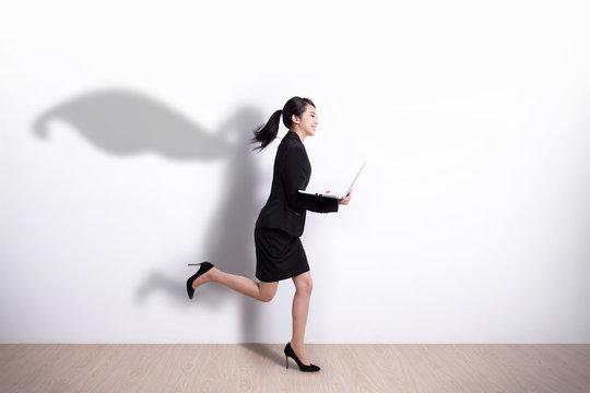 Superhero business woman run