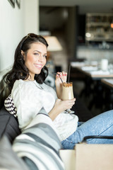 Gorgeous lady sipping coffee in a bar