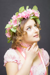 Young woman in image of spring looking up.