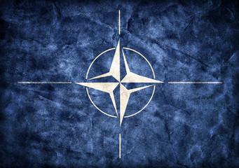 Grunge NATO flag, parchment paper texture.