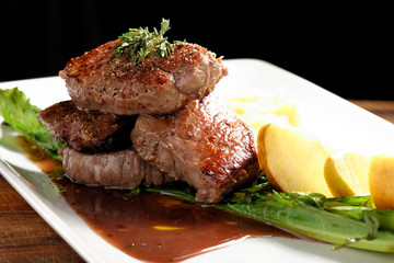 Venison meat steak with potato puree and vegetable