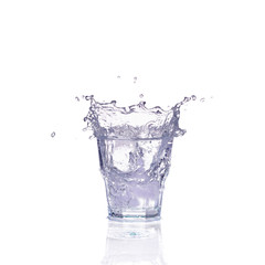 Fresh water splash in a glass isolated on white background