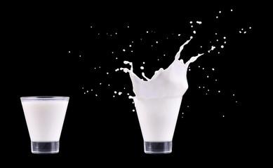 White fresh milk splash in glass on black background