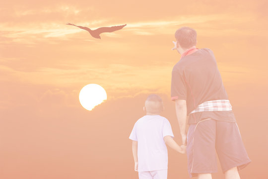 Double Exposure Effect orange screen of sunset father and son