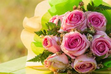 vintage pink rose flower on wooden background