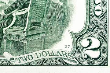 Fragment of two dollar bill. Macro shot.