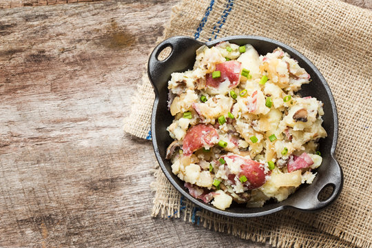 Smashed red potatoes with fried onions and mushrooms