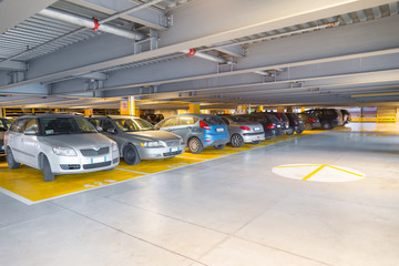 Parking garage, interior with a parked cars