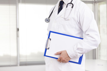 Doctor holding a clipboard at the clinic