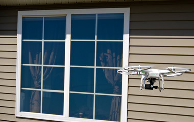 Wall Mural - drone hovering near house window
