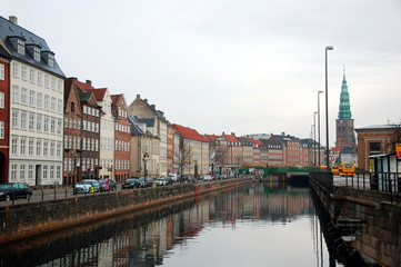 Streets of Copenhagen with its canals, boats and buildings.