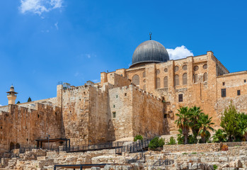 Ancient walls and Al Aqsa Mosque dome in Jerusalem, Israel.