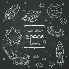 Hand drawn doodle space elements on chalkboard