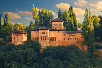 Wall Mural - Alhambra de Granada. Exterior view of Partal area at sunset.