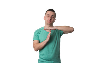 Portrait Of Young Man Gesturing Time Out Sign