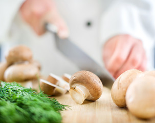 Chef chopping mushrooms
