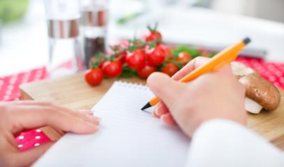 Chef writing the recipe