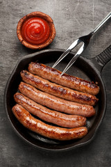 grilled sausages in a pan