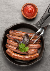 fried  sausages in a pan