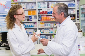 Pharmacists talking together about medication