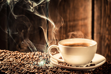 Taste cup of coffee with roasted grains
