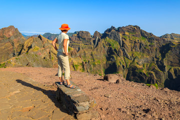Woman tourist on mountain path, Madeira island, Portugal