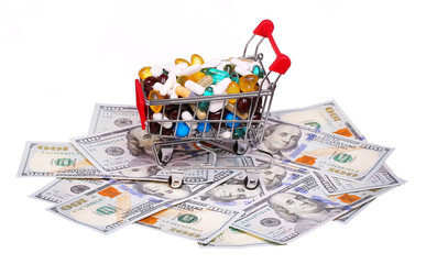 Poster Shopping cart full with pills and capsules over money